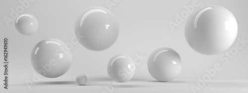 Fotografía 3d rendering of several sized reflected spheres inside a white studio