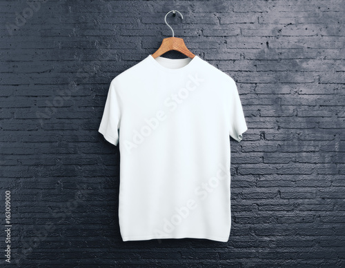 White t-shirt on brick background