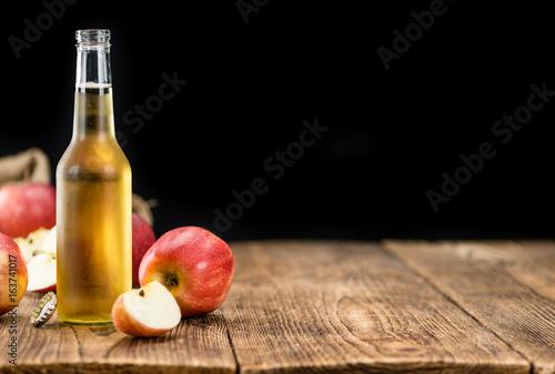Tablou Canvas Apple Cider (selective focus) on vintage wooden background