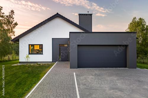 Obraz na plátně Modern house with garage