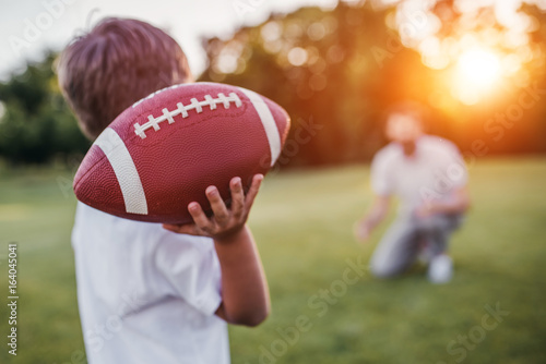 Canvas Print Dad with son playing American football
