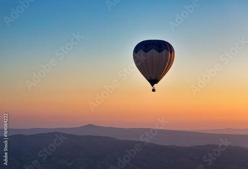Hot air balloon flight at sunrise.