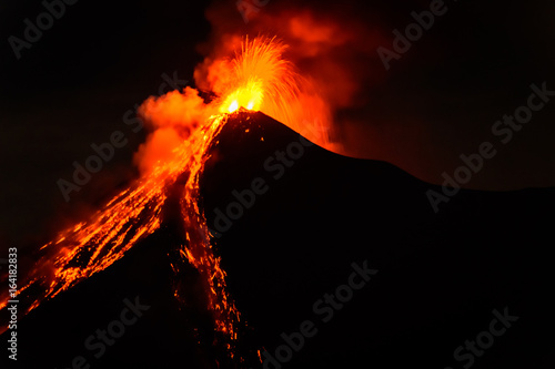 Canvas Print Lava spurts from erupting Fuego volcano in Guatemala