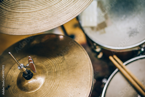 Closeup of drumsticks lying on the drum set Fototapeta