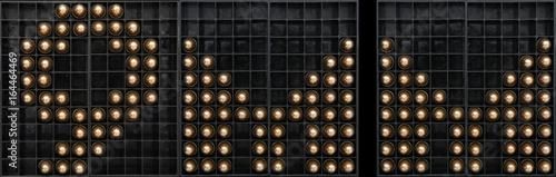 Obraz na płótnie 9mm sign made with rounds on a black ammo tray