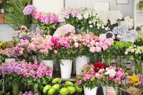Beautiful peonies and other flowers in shop