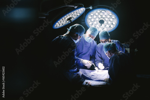 Fotografie, Obraz Group of surgeons in hospital operating theater