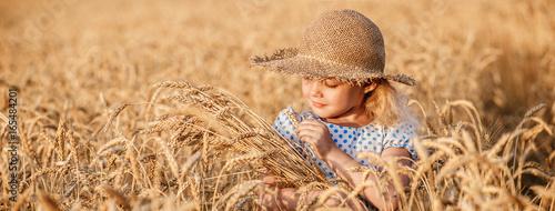 Happy child in autumn wheat field