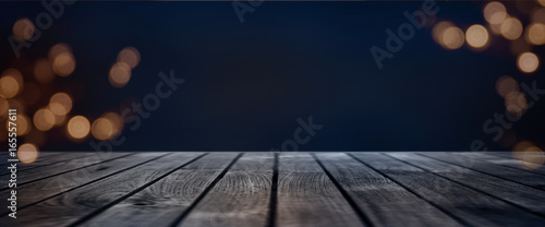 Dark blue bokeh background with wooden stage