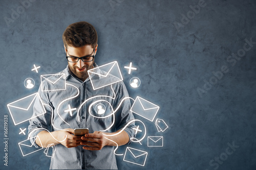 Man using smartphone with email network