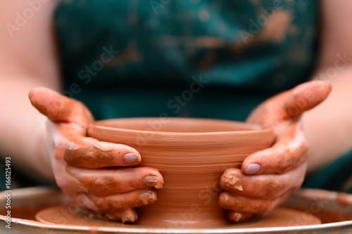 Potter making ceramic pot on the pottery wheel Fototapeta