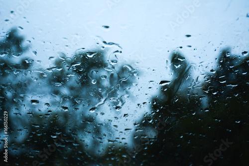 Rain on car windshield during a rainstorm on the road. Fototapeta
