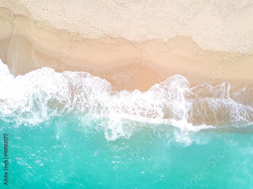 Obraz na płótnie Aerial view of sandy beach and ocean with waves