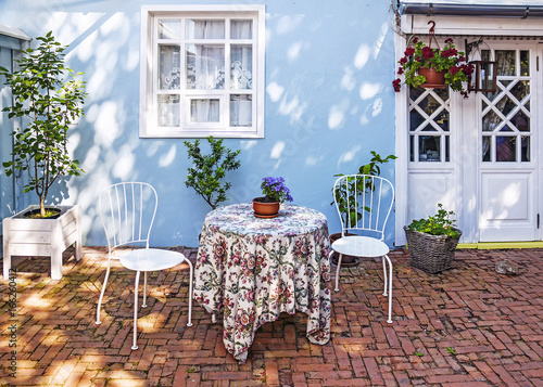 Cozy courtyard of a street cafe Fototapeta