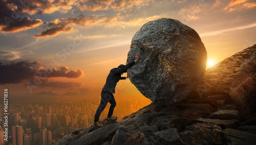 Fotografia Business man pushing large stone up to hill , Business heavy tasks and problems concept