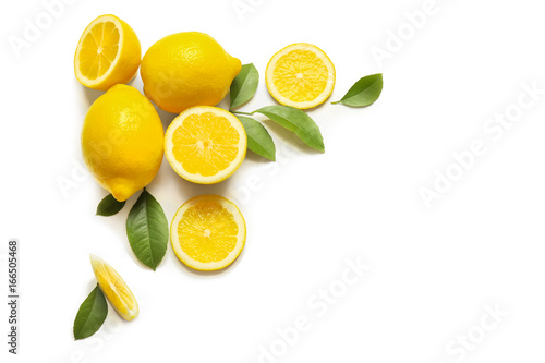 Composition of delicious citrus fruit and green leaves on white background