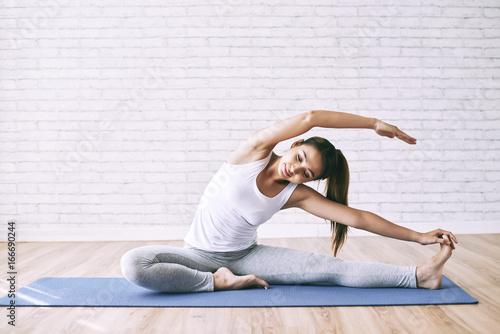 Obraz na płótnie Stretching on the floor