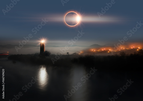 """Solar Eclipse with lighthouse """"Elements of this image furnished by NASA """""""