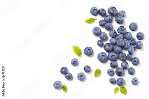 Foto Fresh blueberries and leaves, berry frame isolated on white background, top view