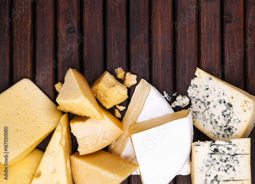 Canvas Print Various types of cheese on rustic wooden table, top view