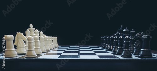 Tablou Canvas Beginning of the game, Two chess teams in front of different color white and bla