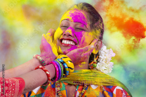 Canvas Print Portrait of  young Indian Woman celebrating Holi color festival