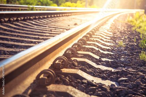 Obraz na plátně Rails and railway going into the distance. Sunny background.