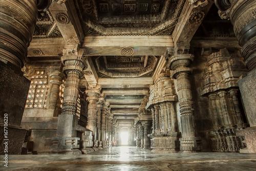 Columns and empty corridor inside the 12th century stone temple Hoysaleswara, now Karnataka state of India