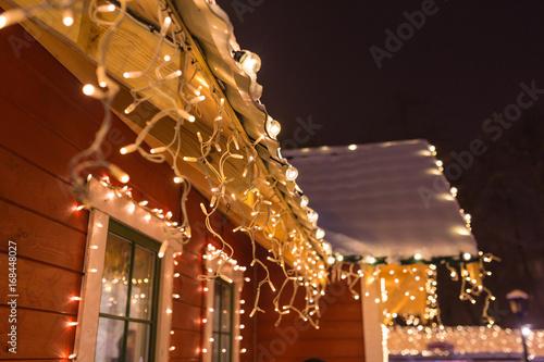 unusual christmas wreath on window.