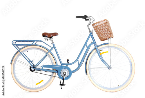 Bicycle with wicker basket on white background