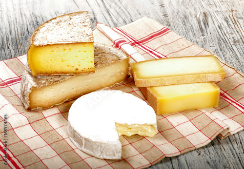 Canvas Print Different french cheeses on a towel