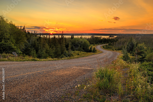 Canvas Print Winding country road sunset