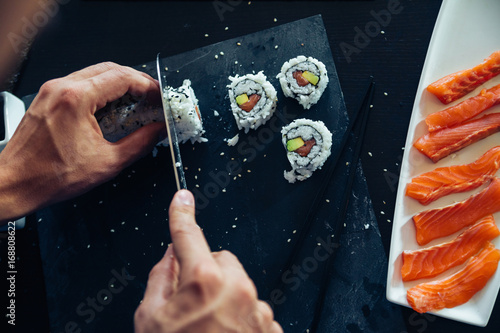 Fotografie, Obraz Sushi Being Cut