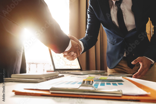 Fotografia Two confident business man shaking hands during a meeting in the office, success