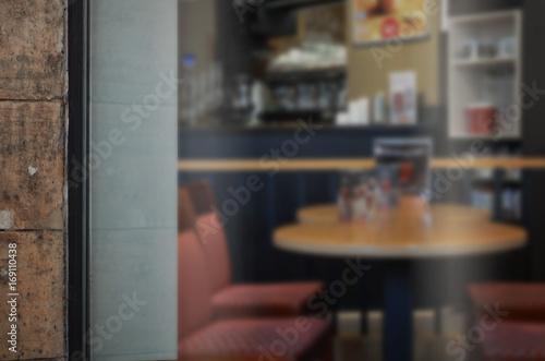 Coffee shop glass door mockup. Empty space on window for add logo Fototapeta
