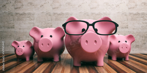 Photo Piggy banks family on wooden floor and marble wall