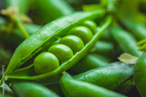 Fresh pea pods and peas closeup, macro