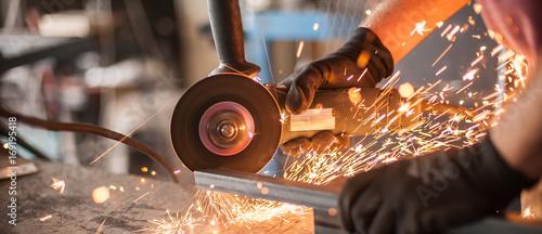 Fotografia, Obraz Electric wheel grinding on steel structure in factory