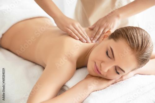Young beautiful woman having massage in spa salon