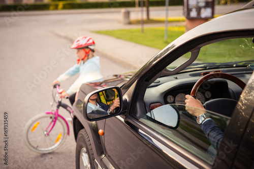 Accident. Girl on the bicycle crosses the road in front of a car