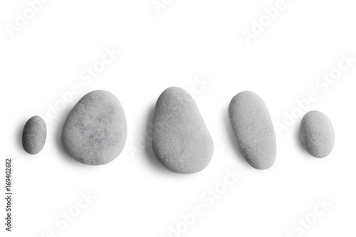 Grey pebbles on white background Fototapeta