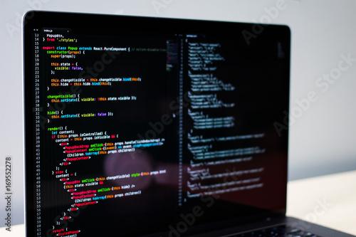 Fototapeta Frontend developer's laptop screen with some JS code