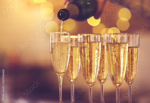 Champagne glasses on gold background. Party concept