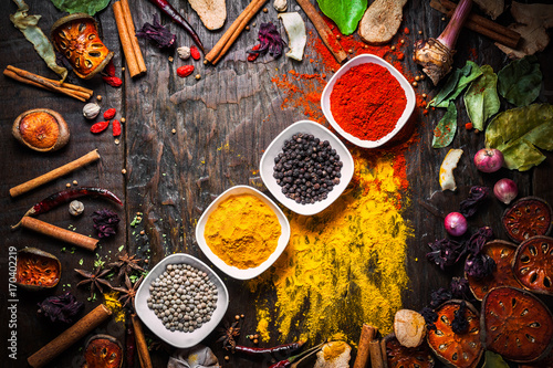 Wallpaper Mural Selection of spices herbs and ingredients for cooking, Food background on wooden table, Top view, Thai cuisine