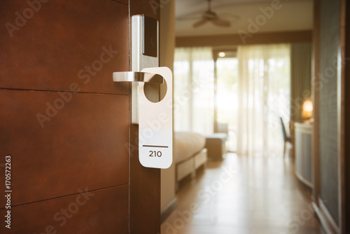 The hotel room with Room Number sign on the door