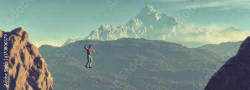Fotografija Young man walking in balance