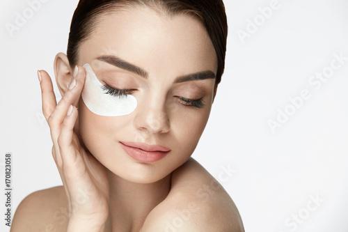 Patch Under Eye. Beautiful Woman With Under Eye Mask On Face Fototapeta