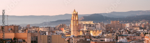 Bell tower of the church of Reus, Prioral de Sant Pere, city of Catalonia, Spain at day