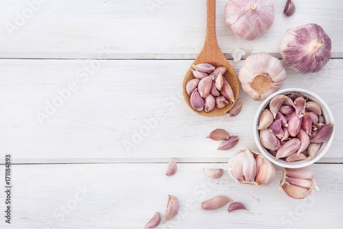 Close up the group of garlic on white wooden table board , top view or overhead shot with copy space