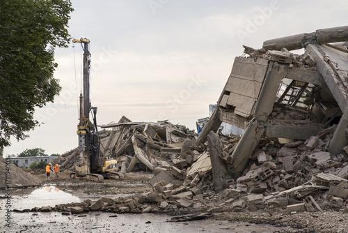 Fotografering Collapsed industrial buildings  with machine driller